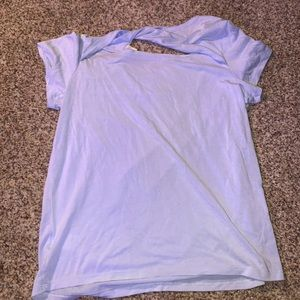 light blue open back shirt